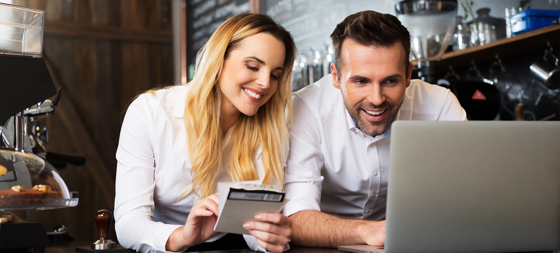 restaurant owners looking at website