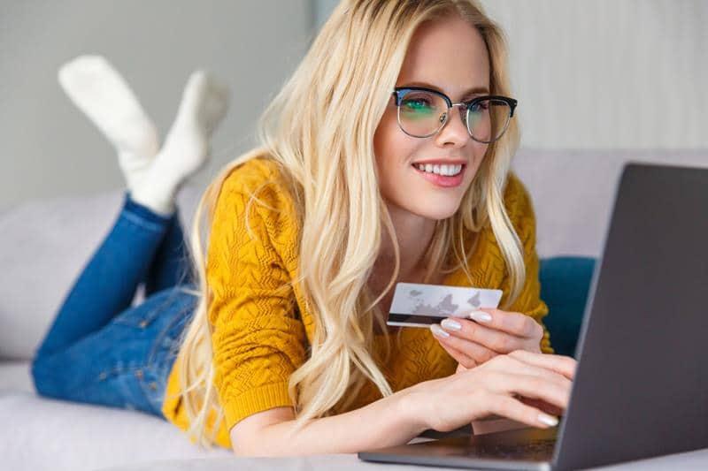 a smiling woman enjoys online shopping